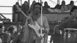 Jimi Hendrix performing his legendary 2 hour performance at Woodstock Music & Arts Festival held on